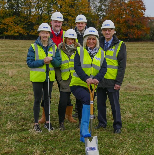 Team members from The Wilberforce Trust and William Birch & Sons gather for the first spade celebration