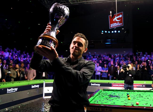 Ronnie O'Sullivan with the trophy after winning the 2018 Betway UK Championship at York Barbican. Picture: Richard Sellers/PA Wire