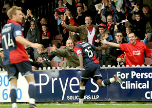 York City striker Michael Rankine  celebrates with fans in the Popular Stand at Bootham Crescent after his goal put  the hosts in front  against  Blue  Square Premier leaders Oxford