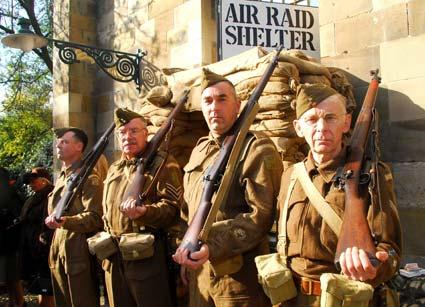 Members of the Home Guard take a breather during Pickering's annual Wartime Weekend.