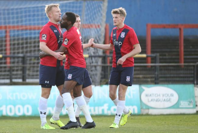 York City's Jordan Burrow is congratulated by team-mates after scoring the winning goal against Alfreton Town on Saturday. Picture: Gordon Clayton