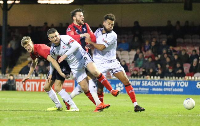 Alfreton Town's Dom Smith and Ryan Qualter manager to keep York City's Alex Kempster and Sean Newton from the ball. Picture: Gordon Clayton
