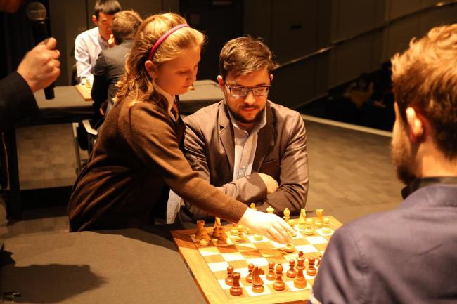Molly Bridel, pictured making the first move against World Chess Champion Magnus Carlsen