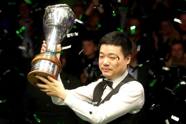 Ding Junhui celebrates with the trophy after winning the Betway UK Snooker Championship at York Barbican. Picture: Richard Sellers/PA Wire