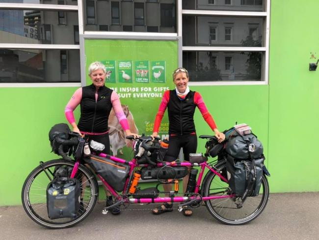Cat Dixon, left, and Raz Marsden with their tandem on their world-record attempt to pedal around the world