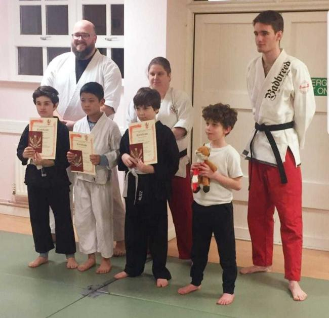 Wu Lay Col jujitsu club's successful students and teachers. Back row: Robert Crawford, Haley Pugh, Will Scott. Front row: Thomas Pugh, Jack Hai and Robert Weeks with their certificates alongside a new student at the club