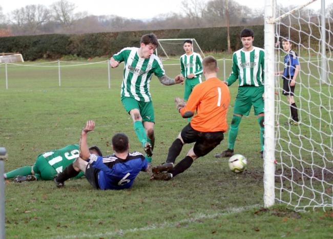 Jake Duckworth completes his hat-trick for Wigginton Grasshoppers in their 12-0 demolition of Church Fenton. Picture: Mark Crow