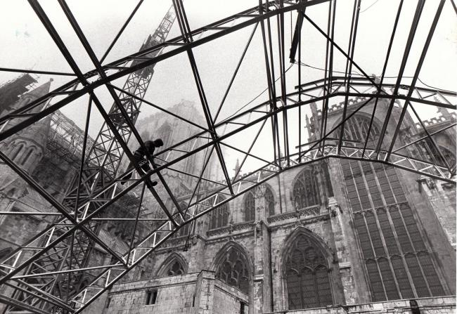 October 1986  The new roof of York Minster's fire-ravaged South Transpet was fully revealed for the first time when a 200ft crane lifted off the two and a half ton metal sections which have supported the temporary roof.  Pictured is workman, Bill Fair