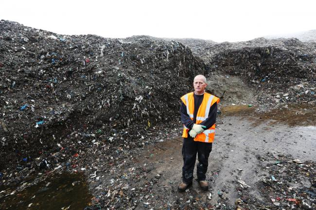 Graham Brocklesby, managing director of BBPL, surveys the pile of rubbish left on his property in Great Heck, Yorkshire, after the collapse of Total Waste Management Ltd, which put it there