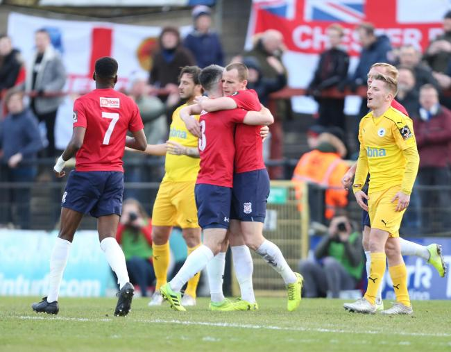 York City midfielder Paddy McLaughlin hugs Kieren Green following his goal against Chester FC in York's 4-2 win over the Blues in February. Picture: Gordon Clayton