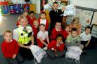 PCSO Kim Copestake and PCSO Chris Pitchford chat to pupils at Haxby Road Primary School, York, about stranger danger