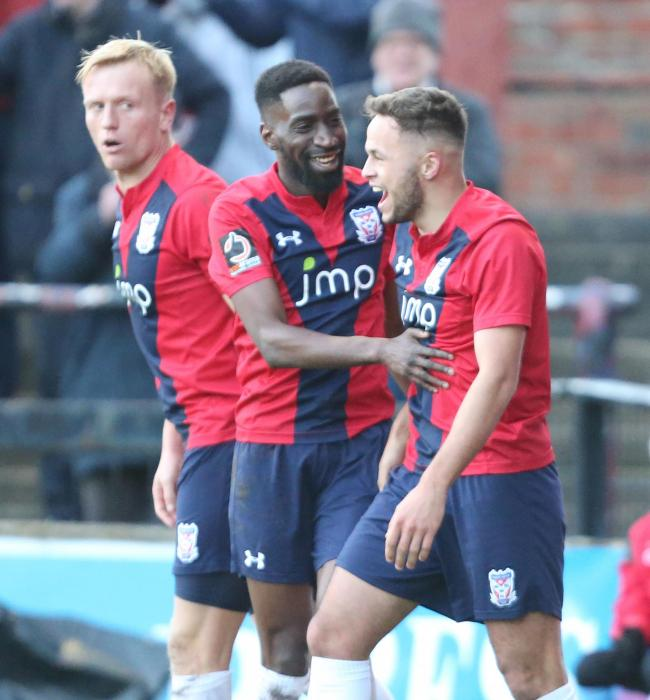 Jordan Burrow, Adriano Moke and Kurt Willoughby celebrate York City's fourth in their win over league rivals Chester. Picture: Gordon Clayton