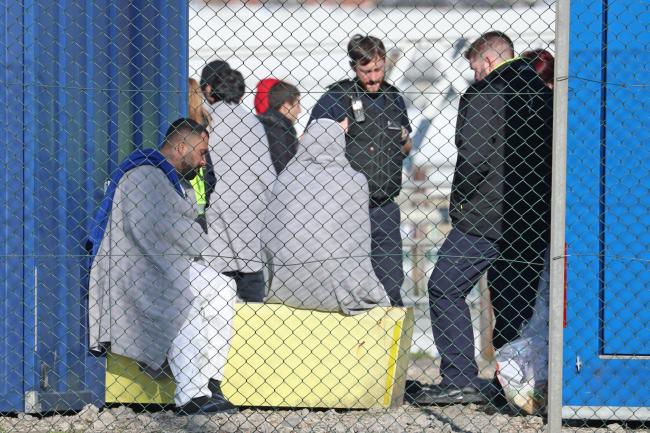 People thought to be migrants at the Port of Dover in Kent