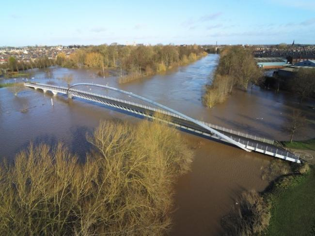 York's Millennium Bridge, surrounded by floodwater Picture by North Yorkshire Police drone