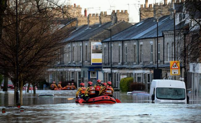 Mountain Rescue teams paddle along Huntington Road after the Foss flooded in 2015 - such scenes are very unlikely to be repeated after Storm Dennis Anna Gowthorpe/PA Wire