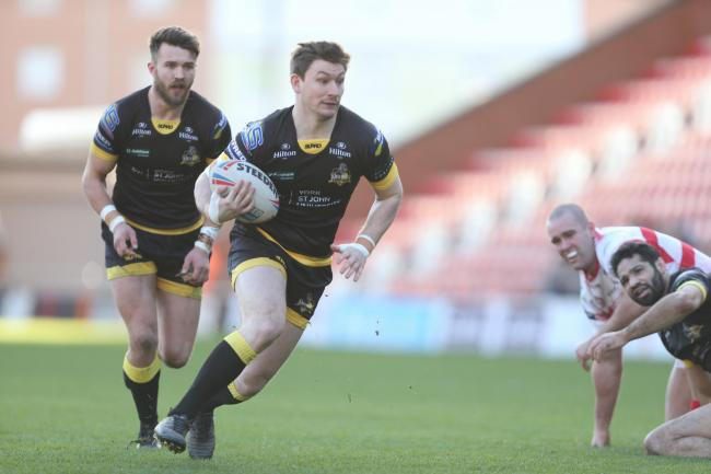 York City Knights hooker Kriss Brining gets away as Leigh Centurions' Nick Glohe and York's Will Sharp look on. Picture: Gordon Clayton