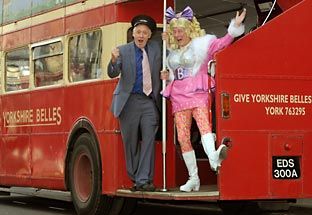 TV presenter Harry Gration, left, and Theatre Royal pantomime dame Berwick Kaler board the double-decker bus during filming