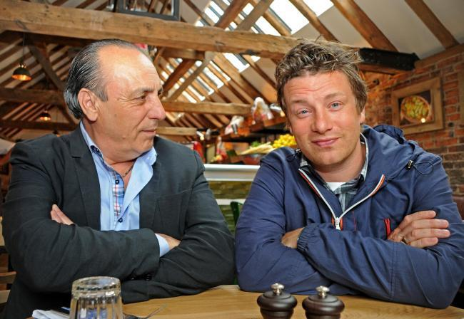 TV chef Jamie Oliver, pictured with his mentor Gennaro Contaldo, at his former restaurant in York which is to become a Tomahawk Steakhouse