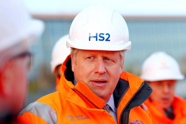 Boris Johnson listens during a visit to Curzon Street railway station in Birmingham where the High Speed 2 (HS2) rail project is under construction