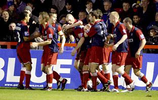 Michael Rankine, centre, is mobbed by his York City team-mates after scoring the winning goal in the Blue Square Premier clash at AFC Wimbledon