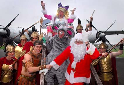 Berwick Kaler and co-stars from Humpty Dumpty meet Santa Claus at the Yorkshire Air Museum, while shooting scenes for the film sequence to be used in the pantomime.