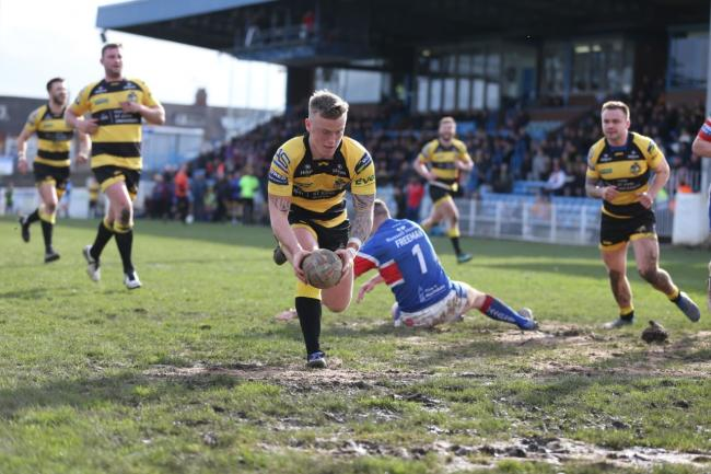 Connor Robinson dots down from Ben Johnston's pass. Picture: Gordon Clayton