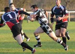 Heworth player-coach Chris Smith drives his side forward against Thatto Heath.