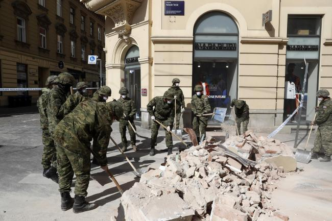 Soldiers clear debris after an earthquake in Zagreb