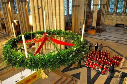 Children from the Minster School decorate the advent wreath inside York Minster.