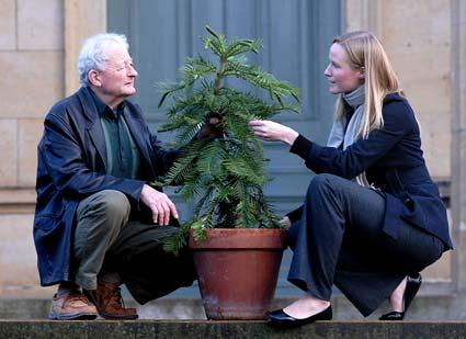 Geologist Jack Doyle presents a Wollemi Pine to Isla Gladstone, of The Yorkshire Museum. One of the world's oldest tree species, only 200 of these living fossils survive in the wild.