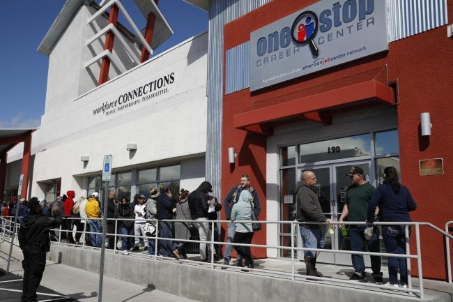 People queue up for help with unemployment benefits in Las Vegas