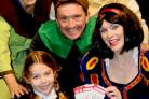 Panto stars from the Grand Opera House's production of Snow White, from left, Audrey Wilson (Growler), Graham Hughes (Colonel), Snow White (Michelle Hardwick) and Denise Dove (Cheerful) with St Oswald's Primary School pupil Emily Hill, seven