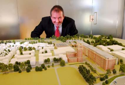 Peter Callaghan, development director for Grantside, unveils a model of the planned development at the Terry's site in York.