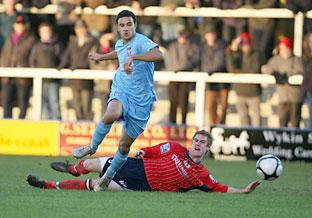 York City's James Meredith beats a Hinckley United opponent to the ball. Picture: Gordon Clayton