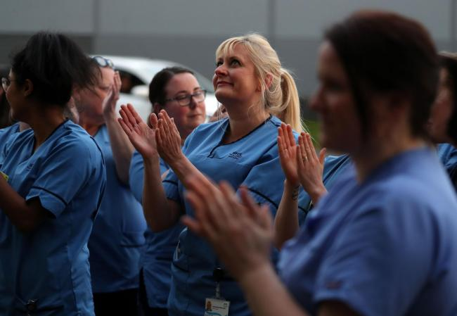 Nursing staff clap their colleagues during the nationwide Clap for Carers, which has become a symbol of national togetherness. Picture: Andrew Milligan/PA Wire.