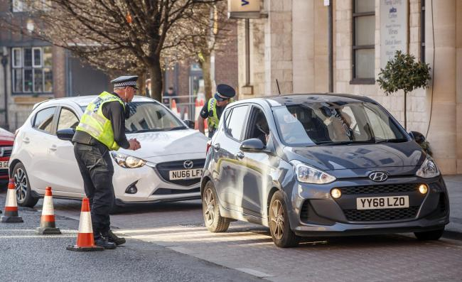 Police checking vehicles in York in the early days of lockdown. But where is the clear national policing policy for coming out of lockdown?, asks our correspondent. Picture: Danny Lawson/PA Wire