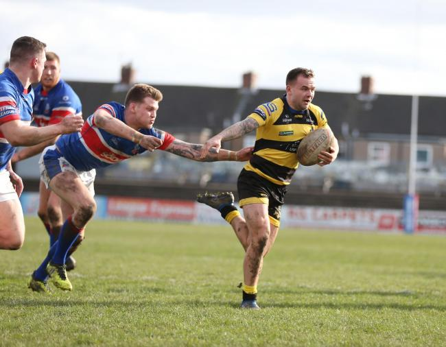 York City Knights half-back ben Johnston fends off a defender during the Knights' 70-12 fifth round Coral Challenge Cup victory over Rochdale Hornets in March. Picture: Gordon Clayton
