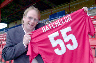 John Batchelor holds his own York City shirt complete with his name and race car number at Bootham Cresent in March 1992