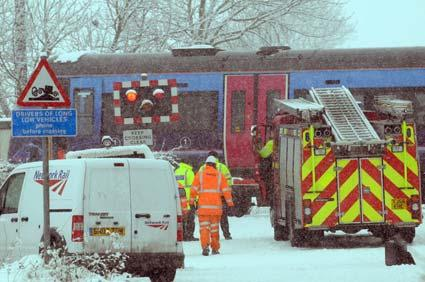 The scene after a car skidded onto the railway track at the level crossing at Hagg Lane, near South Duffield. The driver escaped before the train hit the car causing only minor damage.
