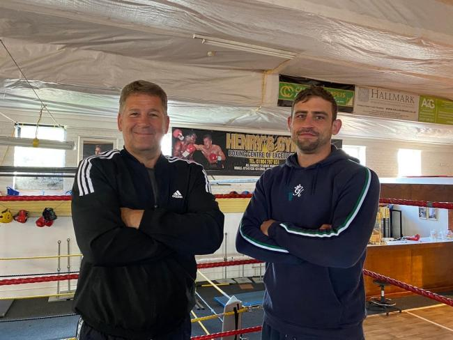 Professional boxer Rob Magill (right) alongside trainer Henry Wharton (left).