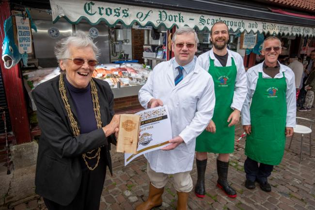 Lord Mayor of York Janet Looker presenting members of the Cross of York team with their Fishmonger of the Year award.