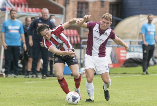York Press: City's Callum Griffiths goes past Altrincham's Connor Hampson