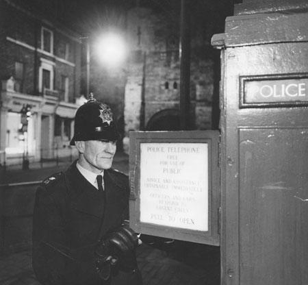 As York sleeps PC Thomas Watkinson reports in to HQ from a police box on Bootham. From the Evening Press, 31/3/1964.