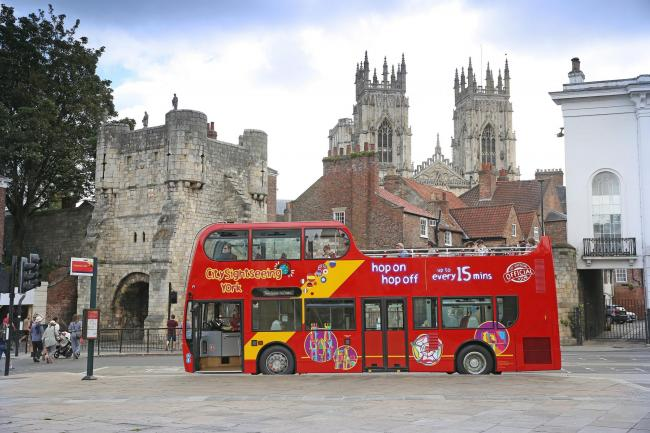 York's bright red City-Sightseeing open top tour buses are offering discounts to residents with a York Card every Sunday