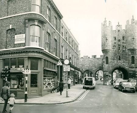 Micklegate Bar in 1972.  The For Sale sign is for the firm Lawson Larg, and the story that went with this picture described how the chemist shop was to be converted in a Victorian style restaurant by Mark Rowntree, then 27-years-old.