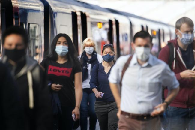 Rail commuters wearing face masks