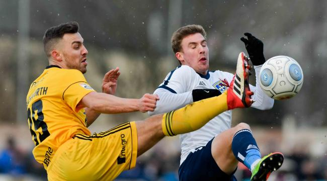 Michael Duckworth (left) in action for FC Halifax Town against Guiseley. Picture: Andy Garbutt