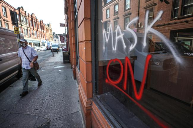 Graffiti urging people to wear a mask: but not all people can
