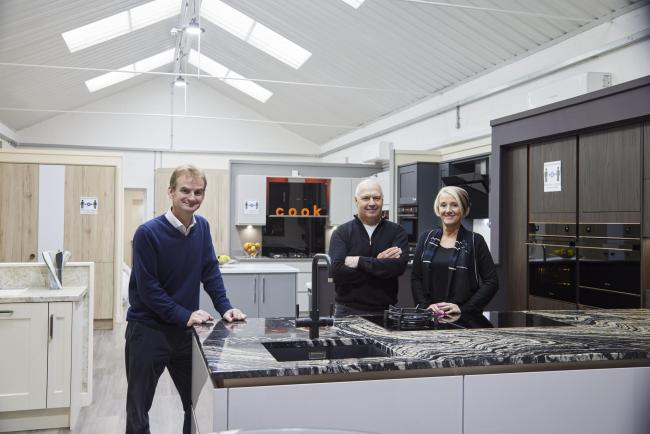 Wharfedale Property management director, Tim Munns, with Simon and Michelle Procter, Buywell Interiors, in their kitchen showroom in a development of new units at Thorp Arch Estate.