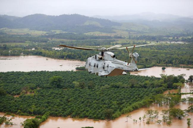A Merlin Helicopter from 845 Naval Air Squadron conducting damage surveys in Honduras